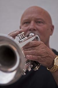 Music teacher and band member, Don Haudenschild, playing trumpet