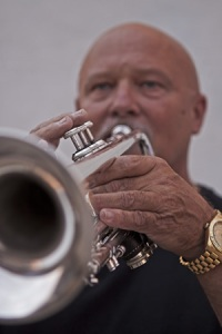Music teacher and band member, Don Haudenschild, playing trumpet